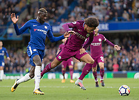 Football - 2017 / 2018 Premier League - Chelsea vs Manchester City<br /> <br /> <br /> Leroy Sane (Manchester City) gets clipped by Tiemoue Bakayoko (Chelsea FC) as he races for the ball at Stamford Bridge <br /> <br /> COLORSPORT/DANIEL BEARHAM