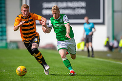 Alloa Athletic's Jon Robertson and Hibernian's Daryl Horgan. Half time : Hibernian 0 v 0 Alloa Athletic, Betfred Cup game played Saturday 20th July at Easter Road, Edinburgh.