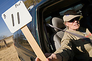 02 APRIL 2006 - THREE POINTS, AZ: WANDA WEATHORFORD, a Minuteman volunteer from Denver, CO, holds up a placard indicating her observation post assignment during the Minuteman Project action between Three Points, AZ, and Sasabe, AZ, about 50 miles south of Tucson, AZ, April, 2, 2006. Volunteers from the Minuteman Project have set up lines of observation posts on remote county roads in the desert southwest of Tucson to monitor the area for illegal immigrant traffic. On Saturday night, the first night of the action, Minuteman volunteers spotted more than 50 illegal immigrants and claim their tips to the US Border Patrol led to the apprehension of at least 16 of those immigrants.  Photo by Jack Kurtz