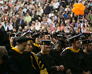 Graduates enter Gordon Field House at the start of RIT's Convocation Ceremony in Rochester on Friday, May 22, 2015.