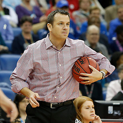 Apr 9, 2013; New Orleans, LA, USA; Louisville Cardinals head coach Jeff Walz holds the basketball against the Connecticut Huskies during the second half of the championship game in the 2013 NCAA womens Final Four at the New Orleans Arena. Mandatory Credit: Derick E. Hingle-USA TODAY Sports