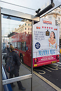 Bus rear advertising for Abba's West End musical Mamma Mia as it stops while driving through central London streets.