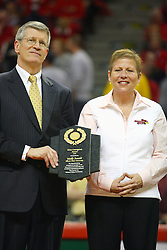 "31 January 2009: Missouri Valley Commissioner Doug Elgin presents Molly Arnold with the conferences Most Courageous Award.  Molly battle cancer. The Illinois State University Redbirds join the Bradley Braves in a tie for 2nd place in ""The Valley"" with a 69-65 win on Doug Collins Court inside Redbird Arena on the campus of Illinois State University in Normal Illinois"