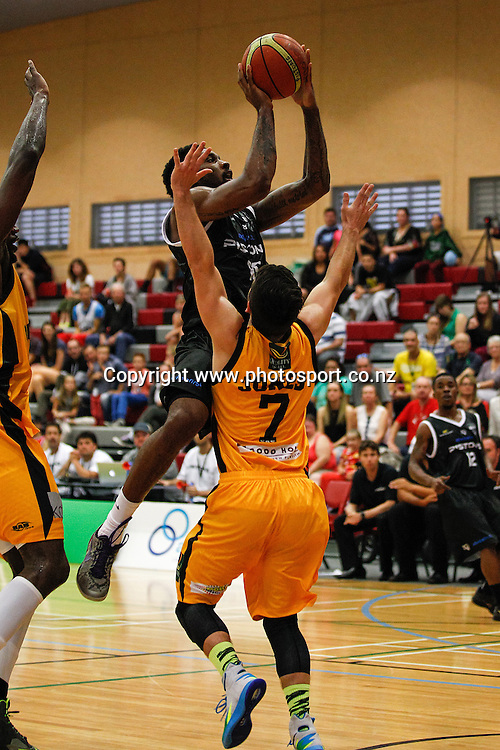 Waikato Pistons import Akeem Wright shoots over Taranaki Mountain Airs Aled Jones during the NBL basketball match - Waikato v Taranaki at Hamilton Boys High School, Hamilton on Sunday 13 April 2014.  Photo:  Bruce Lim / www.photosport.co.nz