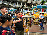 16 AUGUST 2016 - BANGKOK, THAILAND: People light incense at Erawan Shrine one year after the shrine was bombed in the worst international terrorist attack in Thai history. On 17 August 2015, a bomb was set off at the Erawan Shrine, a popular tourist attraction and important religious shrine in the heart of the Bangkok shopping district. According to the Royal Thai Police  20 people were killed in the bombing and 125 injured. Thai Police arrested an alleged Uighur extremist for the bombing. The case against him is still pending in Thai courts. The shrine was repaired, rededicated and reopened to the public on 4 September 2015.      PHOTO BY JACK KURTZ