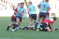 28-07-18 Emirates Airline Park, Johannesburg. Super Rugby semi-final Emirates Lions vs NSW Waratahs. 2nd half. scrum-half Nick Phipps tackle by flanker Kwagga Smith. <br />  Picture: Karen Sandison/African News Agency (ANA)
