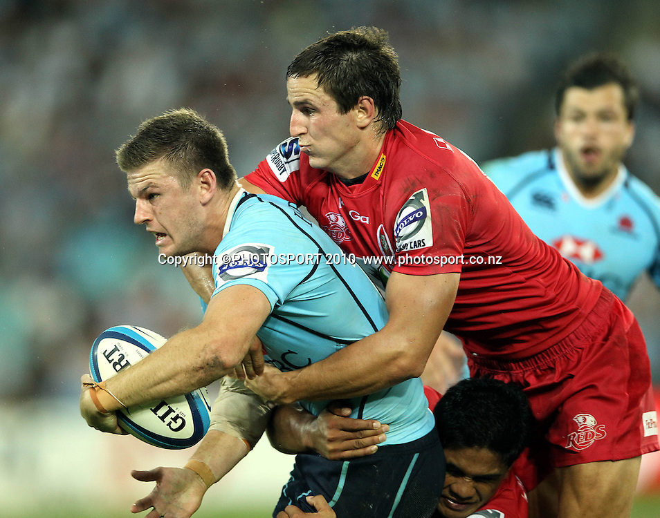 Rob Horne tackled by Mike Harris<br /> Super Rugby union match, Waratahs vs Reds, Sydney, Australia. <br /> Saturday 25 February 2012. Photo: Paul Seiser/PHOTOSPORT