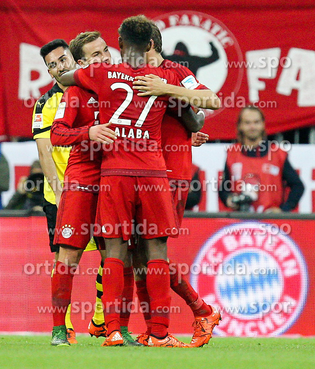 04.10.2015, Allianz Arena, Muenchen, GER, 1. FBL, FC Bayern Muenchen vs Borussia Dortmund, 8. Runde, im Bild l-r: enttaeuschung bei Ilkay Guendogan #8 (Borussia Dortmund), Torjubel von Mario Goetze #19 (FC Bayern Muenchen), David Alaba #27 (FC Bayern Muenchen) // during the German Bundesliga 8th round match between FC Bayern Munich and Borussia Dortmund at the Allianz Arena in Muenchen, Germany on 2015/10/04. EXPA Pictures &copy; 2015, PhotoCredit: EXPA/ Eibner-Pressefoto/ Kolbert<br /> <br /> *****ATTENTION - OUT of GER*****