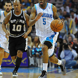Jan 18, 2010; New Orleans, LA, USA; New Orleans Hornets guard Marcus Thornton (5) drives past San Antonio Spurs guard Keith Bogans (10) during the second half at the New Orleans Arena. The Spurs defeated the Hornets 97-90. Mandatory Credit: Derick E. Hingle-US PRESSWIRE