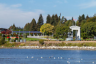 The Peace Arch Border Crossing between Blaine (Washington, USA) and Surrey ( British Columbia, Canada). The Peace Arch was opened in 1912 to commemorate the Treaty of Ghent. Photographed from Blaine Marine Park in Blaine, Washington State, USA.  Also known as the Douglas Border Crossing.
