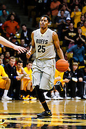 November 13th, 2013:  Colorado Buffaloes junior guard Spencer Dinwiddie (25) runs the ball up court in the second half of the NCAA Basketball game between the University of Wyoming Cowboys and the University of Colorado Buffaloes at the Coors Events Center in Boulder, Colorado