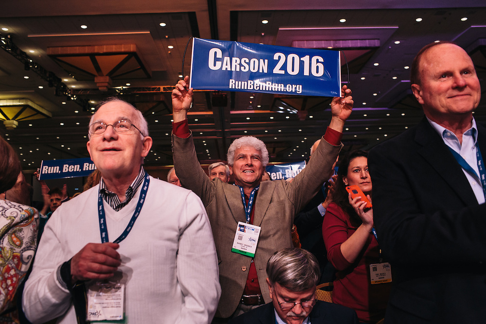 Barney Brenner, center, and others give Dr. Ben Carson a standing ovation during the final day of the Conservative Political Action Conference (CPAC) at the Gaylord National Resort & Convention Center in National Harbor, Md.