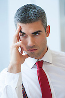 Close-up of pensive Businessman looking off camera
