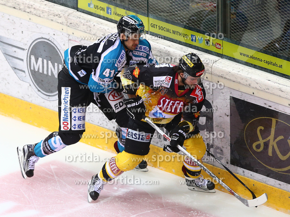 20.12.2015, Albert Schultz Eishalle, Wien, AUT, EBEL, UPC Vienna Capitals vs EHC Liwest Black Wings Linz, 33. Runde, im Bild Mario Altmann (EHC Liwest Black Wings Linz) und Michael Schiechl (UPC Vienna Capitals) // during the Erste Bank Icehockey League 33rd Round match between UPC Vienna Capitals and EHC Liwest Black Wings Linz at the Albert Schultz Ice Arena, Vienna, Austria on 2015/12/20. EXPA Pictures © 2015, PhotoCredit: EXPA/ Thomas Haumer