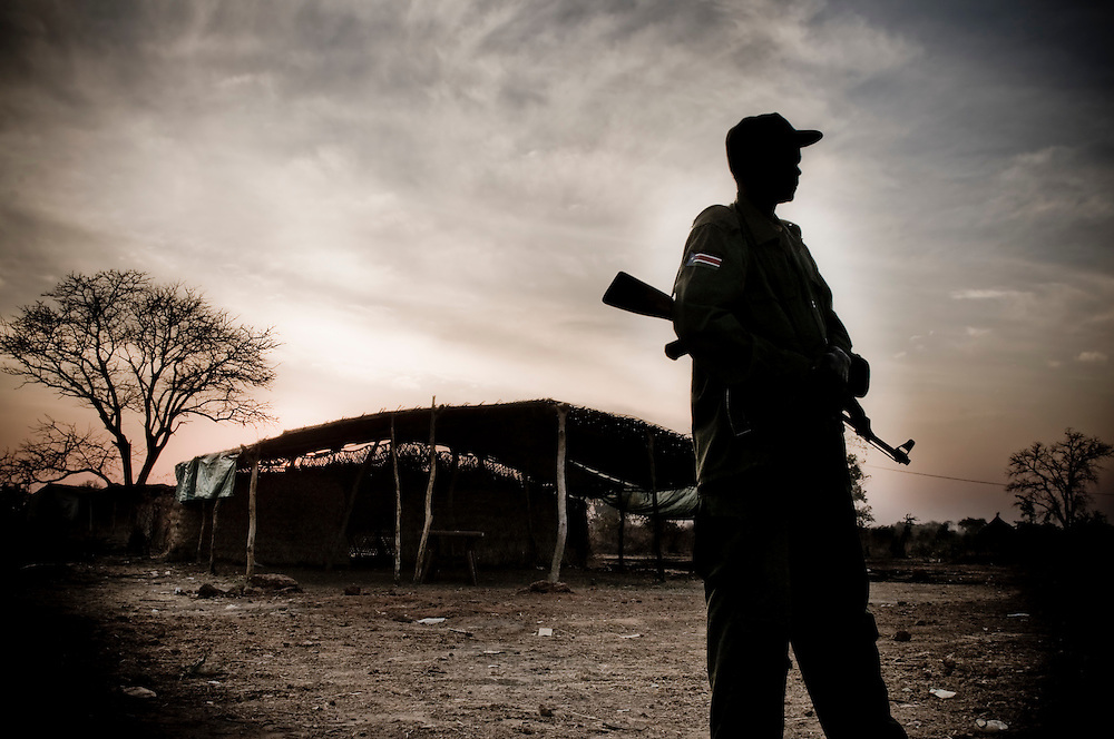 Soldiers with the SPLA wake up at an oupost near the airport in the Southern Sudanese town of Aweil. The area near the border with the North remains tense, with several clashes and attacks on caravans of Southerners returning home being attacked and killed. Sudan recently voted on whether or not to remain with the North or to set out alone as the world's newest nation. (© William B. Plowman)