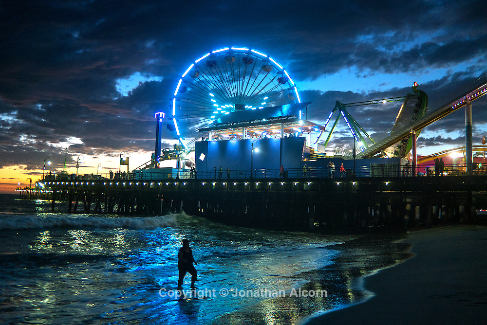 The Pacific Wheel glows in blue at the Santa Monica pier