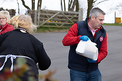 © Licensed to London News Pictures. 30/03/2020. Baddesley, North Warwickshire, UK. MP Delivery. North Warwickshire MP Craig Tracey (right) with volunteers turns delivery man to help deliver meals in his constituency. When Atherstone coffee shop owner Angie Spencer decided to make meals for people who were housebound she asked for volunteers to help deliver the meals. The local community responded along with local MP Craig Tracey. The meals will be delivered on Mondays and Fridays to start with, the first going out today (Monday 30th March) with over 100 meals being delivered. Angie has put out a request for more drivers should the need rise. Angie, a local town councillor started the idea along with business partner Stephen Reay and asked Warwickshire County Council to help with the scheme. Photo credit: Dave Warren / LNP