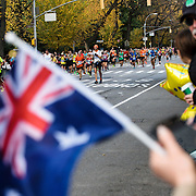 NYTRUN - NOV. 6, 2016 - NEW YORK - A spectator holds an Australian flag as runners in the 2016 TCS New York City Marathon head down 5th Ave. near E 91st Street on Sunday afternoon. NYTCREDIT:  Karsten Moran for The New York Times