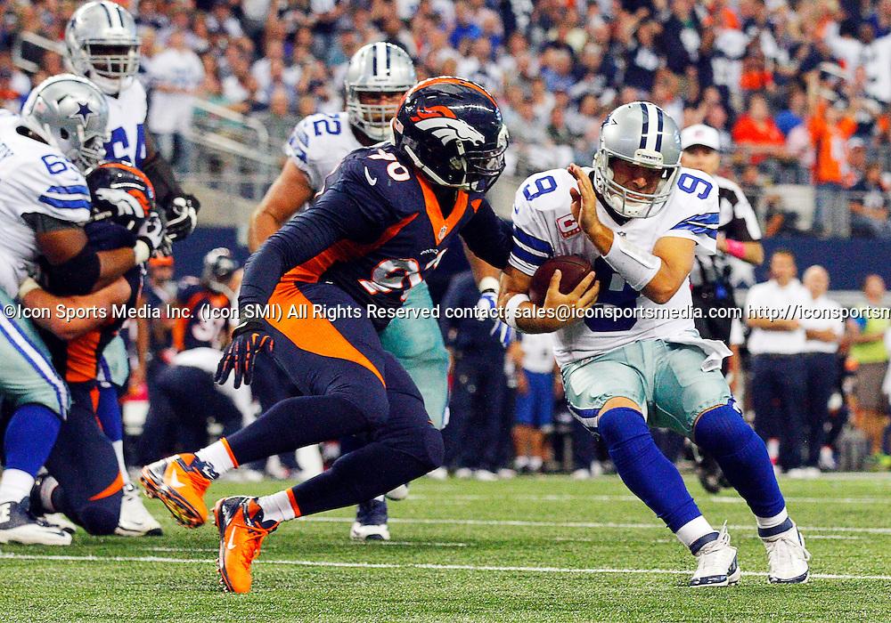 06 OCTOBER 2013: Denver Broncos defensive end Shaun Phillips (90) tackles Dallas Cowboys quarterback Tony Romo (9) on 2-point conversation during a regular season NFL football game between the Denver Broncos and Dallas Cowboys at AT&T Stadium in Arlington, TX. Denver won 51-48.
