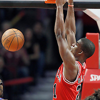12 March 2012: Chicago Bulls guard Jimmy Butler (21) dunks the ball during the Chicago Bulls 104-99 victory over the New York Knicks at the United Center, Chicago, Illinois, USA.