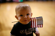 Dylan Curry, 11 months old, carries a U.S. flag in his mouth as he waits for his U.S. Army soldier father to return from Iraq before a ceremony at Fort Carson in Colorado Springs, Colorado February 12, 2009.  About 280 soldiers from the 3rd Brigade Combat Team, 4th Infantry Division returned following their 15-month deployment to Iraq.  REUTERS/Rick Wilking (UNITED STATES)