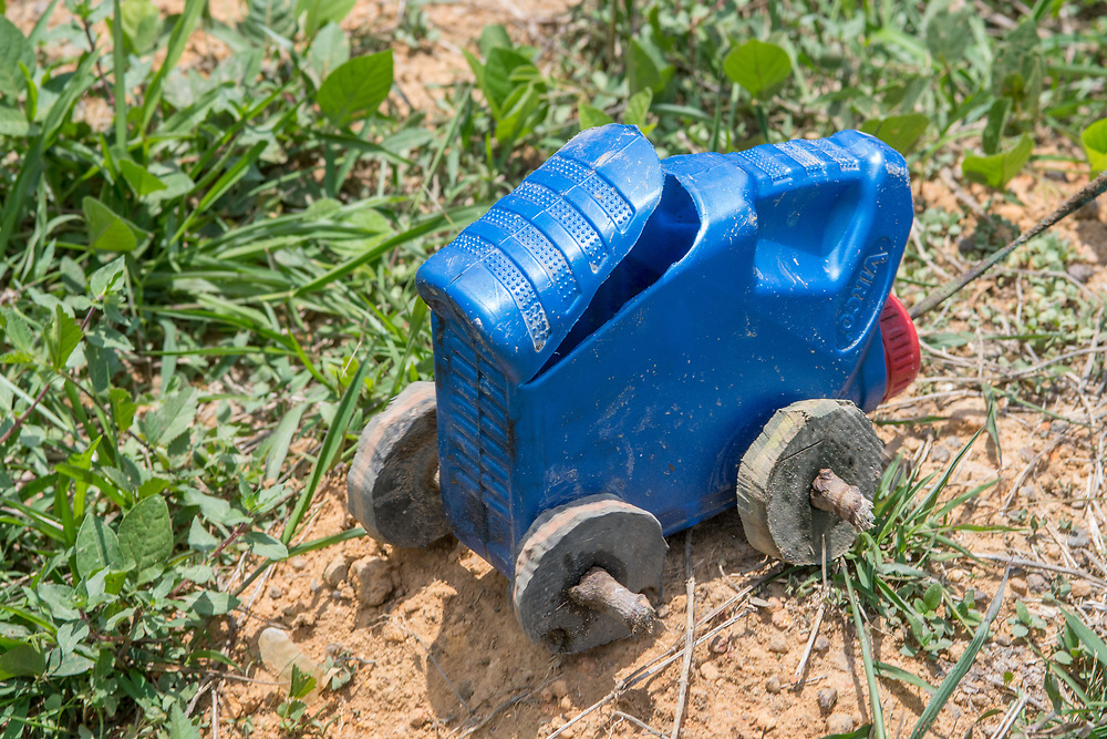 A toy car made from a gasoline can rests on the ground in Ganta, Liberia