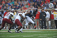 Mississippi's Laquon Treadwell (1) eludes Troy safety Camren Hudson (1) and Troy linebacker Mark Wilson (35) to score at Vaught-Hemingway Stadium in Oxford, Miss. on Saturday, November 16, 2013. Ole Miss won 51-21.