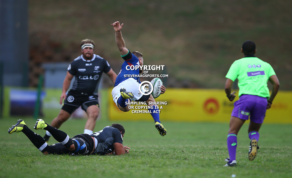 DURBAN, SOUTH AFRICA - APRIL 23: Stephan Coetzee of the Cell C Sharks XV with a tap tackle on Johann Tromp of the Windhoek Draught Welwitschias during the Provincial Cup match between Cell C Sharks XV and Windhoek Draught Welwitschias at King Zwelithini Stadium on April 23, 2016 in Durban, South Africa. (Photo by Steve Haag/Gallo Images)
