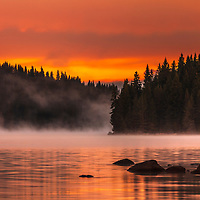 Autumn scene from the mountain lake at dawn