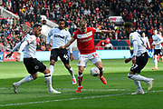 Andreas Weimann (14) of Bristol City is surrounded by Derby players during the EFL Sky Bet Championship match between Bristol City and Derby County at Ashton Gate, Bristol, England on 27 April 2019.