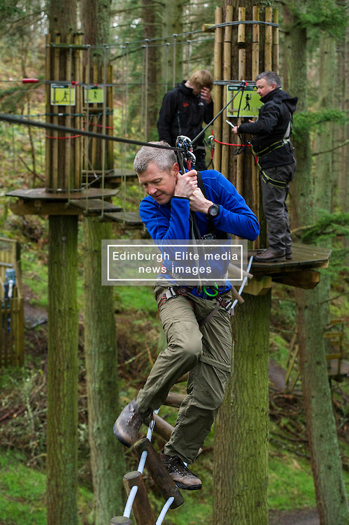 Pictured: Action man Willie Rennie was at ease on the high tightrope as well as the political tightrope.<br /> <br /> Scottish Liberal Democrat leader Willie Rennie joined South of Scotland Liberal Democrat candidate Jim Hume at Go Ape in Glentress Forest, near Peebles. During his visit to the forest, Mr Rennie set out Liberal Democrat plans to ensure that Scotland starts hitting our climate change targets. <br /> Ger Harley | EEm 4 April 2016