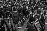 Protestors gather at Brooklyn Borough Hall to pray before a rally in protest President Donald Trump's immigration order Thursday, Feb. 2, 2017, in New York.