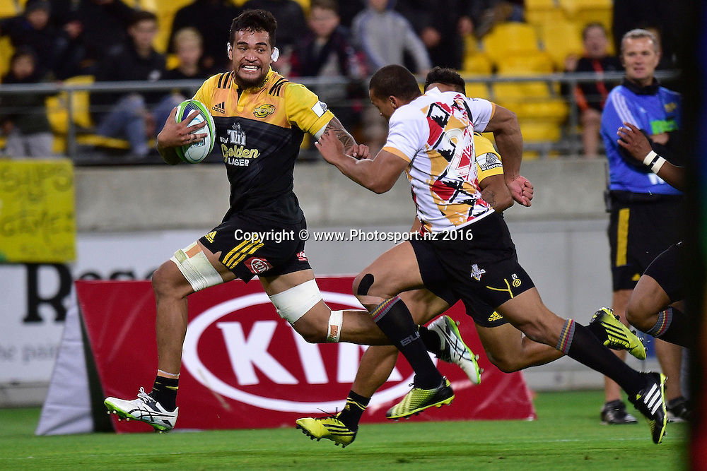 Vaea Fifita (L) of the Hurricanes fends off Elgar Watts of the Southern Kings during the Hurricanes vs Kings Super Rugby  match at the Westpac Stadium in Wellington on Friday the 25th of March 2016. Copyright Photo by Marty Melville / www.Photosport.nz