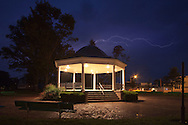 Lightning flashes through the sky over the Central Park gazebo in Elmwood, IL.