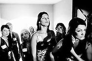 San Sebastiano al Vesuvio, Italia - 28 luglio 2011.Le trans partecipanti al concorso di bellezza per transessuali di Miss Trans Campania 2011 attendo il loro turno prima di scendere in passerella per la sfilata. .Ph. Roberto Salomone Ag. Controluce.ITALY - Trangenders wait to exit the backstage before the beginning of Miss Transgender Campania 2011 in San Sebastiano al Vesuvio on July 28, 2011.