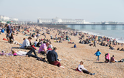 © London News Pictures. 09/03/2014. Brighton UK. Members of the public enjoy the warm weather on Brighton Seafront. With Temperatures expected to hit 18 degrees over the weekend, areas of England are set for the warmest temperatures this year. Photo credit: LNP