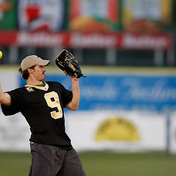 Apr 28, 2010; Metairie, LA, USA; Drew Brees (9) throws the ball during the Heath Evans Foundation charity softball featuring teammates of the Super Bowl XLIV Champion New Orleans Saints at Zephyrs Field.  Mandatory Credit: Derick E. Hingle-US-PRESSWIRE.