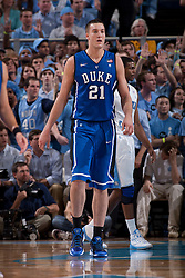 CHAPEL HILL, NC - MARCH 05: Miles Plumlee #21 of the Duke Blue Devils looks to his bench while playing the North Carolina Tar Heels on March 05, 2011 at the Dean E. Smith Center in Chapel Hill, North Carolina. North Carolina won 67-81. (Photo by Peyton Williams/UNC/Getty Images) *** Local Caption *** Miles Plumlee