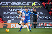 Doncaster Rovers forward Tyler Smith (18) gets in a shot but the flag is up in the background during the EFL Sky Bet League 1 match between Doncaster Rovers and Peterborough United at the Keepmoat Stadium, Doncaster, England on 9 February 2019.