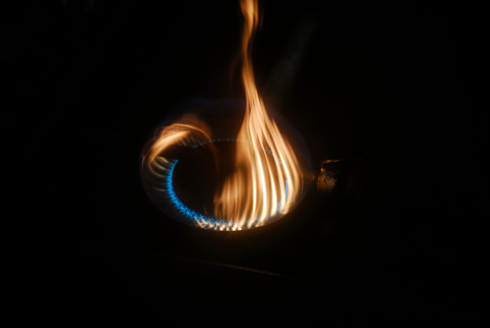 Alaska, Barrow. Fire from a Coleman stove at whaling camp.  Spring 2007