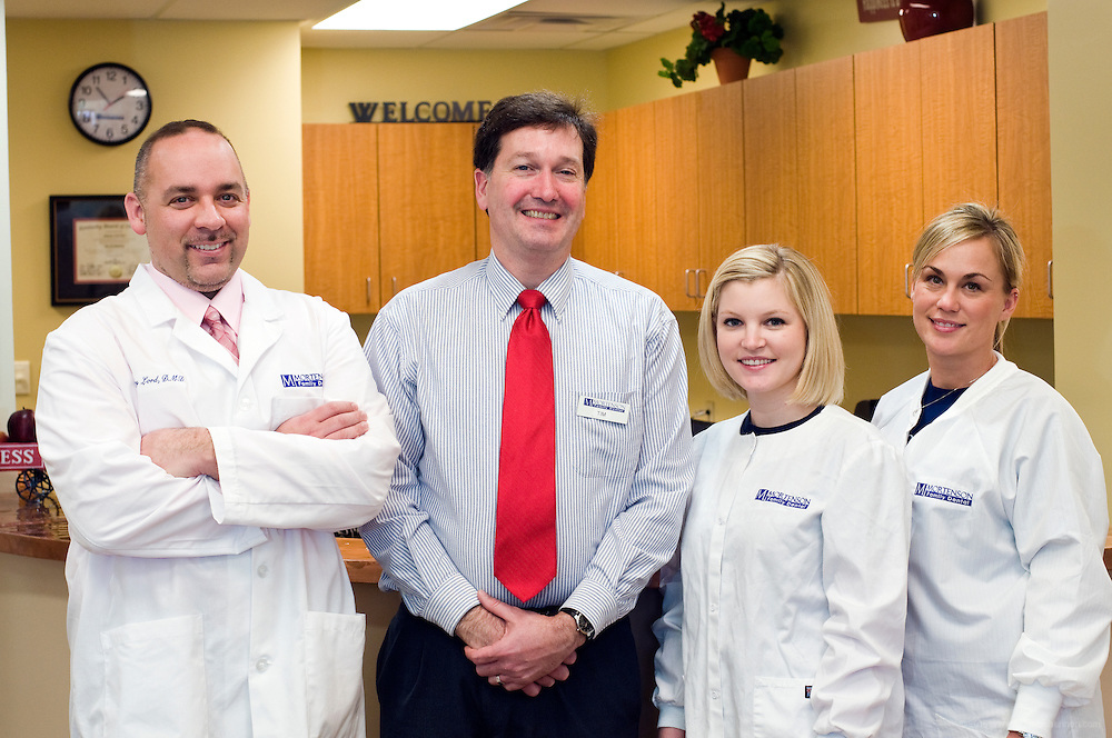 The staff at Mortenson's Family Dental Center: Dr. Gregory Lord, dentist; Tim Crook, office manager; Whitnie Nunally, hygenist;, and Lisa Ferriell, assistant, photographed Monday, Jan. 12, 2009 in Louisville, Ky., for The Highlander. (Photo by Brian Bohannon/www.brianbohannon.com)