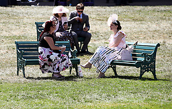 Racegoers sit benches during day four of Royal Ascot at Ascot Racecourse. PRESS ASSOCIATION Photo. Picture date: Friday June 22, 2018. See PA story RACING Ascot. Photo credit should read: John Walton/PA Wire. RESTRICTIONS: Use subject to restrictions. Editorial use only, no commercial or promotional use. No private sales.