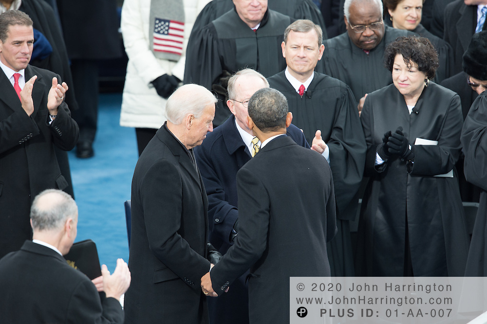 President Obama is greeted by Vice President Biden at the conclusion of President Obama's second inaugural address during the 57th Presidential Inauguration of President Barack Obama at the U.S. Capitol Building in Washington, DC January 21, 2013.