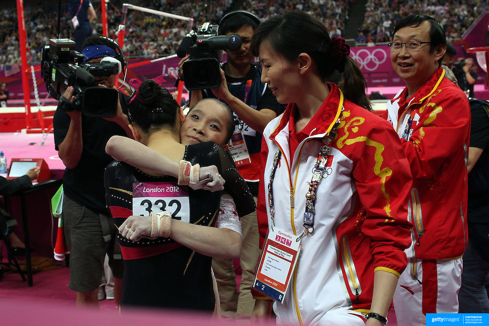 Kexin He, China, (left) is congratulated by team mate Jinnan Yao after winning the Silver Medal in the Gymnastics Artistic, Women's Apparatus, Uneven Bars Final at the London 2012 Olympic games. London, UK. 6th August 2012. Photo Tim Clayton