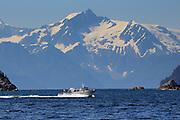 A fishing boat crosses Resurrection Bay near Seward, Alaska.