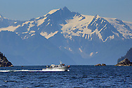 A fishing boat crosses Resurrection Bay near Seward, Alaska.