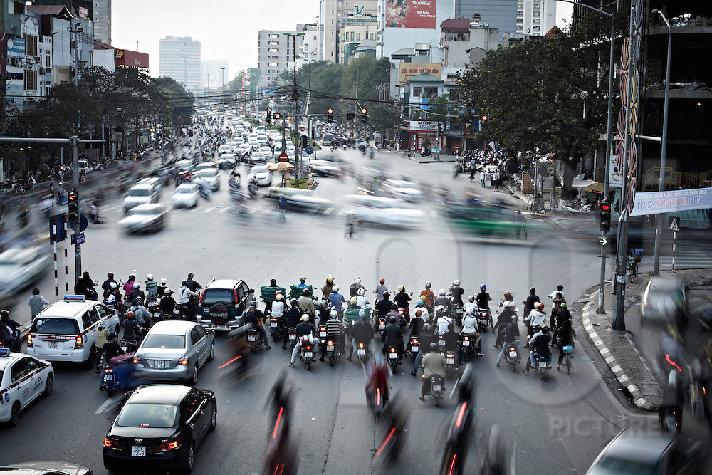 Long exposure of traffic flow through Dai Co Viet intersection in Hanoi, Vietnam, Southeast Asia
