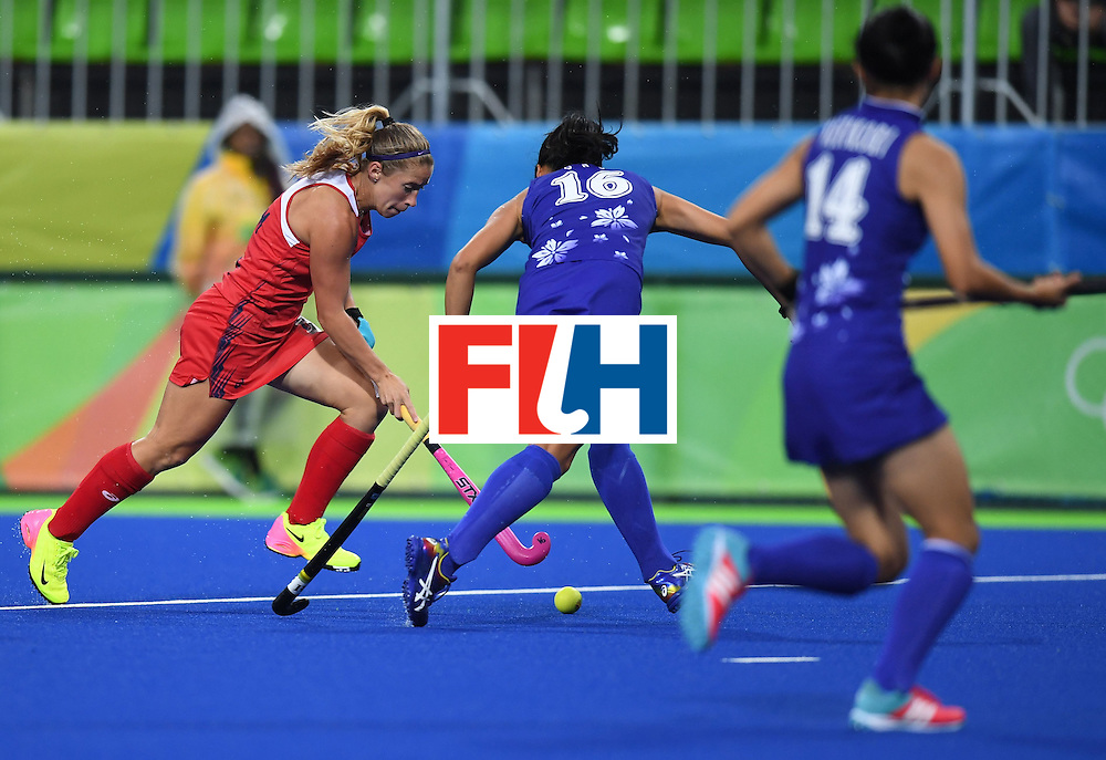 The USA's Katie Bam (L) runs with the ball during the women's field hockey USA vs Japan match of the Rio 2016 Olympics Games at the Olympic Hockey Centre in Rio de Janeiro on August, 10 2016. / AFP / MANAN VATSYAYANA        (Photo credit should read MANAN VATSYAYANA/AFP/Getty Images)