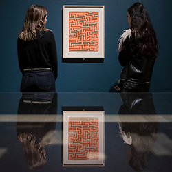 "© Licensed to London News Pictures. 09/10/2018. LONDON, UK. Visitors view ""Red Meander"", 1954, by Anni Albers. Preview of the UK's first exhibition of works by German artist Anni Albers at Tate Modern who used the ancient art of hand-weaving to produce works of modern art.  Over 350 of her artworks from major collections from Europe and the US are on show 11 October to 27 January 2019.  Photo credit: Stephen Chung/LNP"