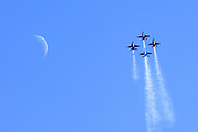 With the moon high in the afternoon sky, the Blue Angels fly over MCAS Miramar during the 2011 Miramar Air Show. Photo by John Lill